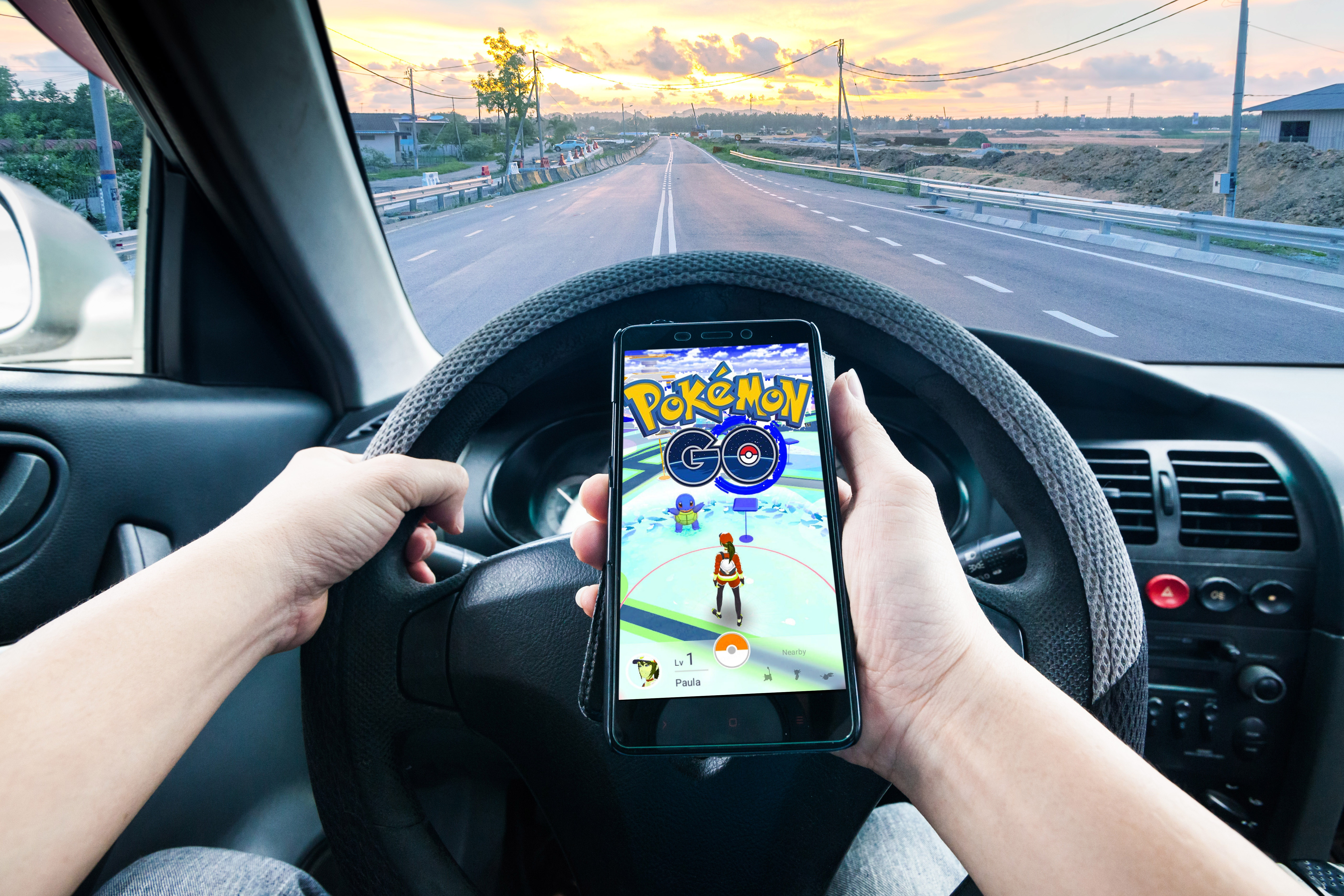 Do not drive and play pokemon go, like this picture shows.