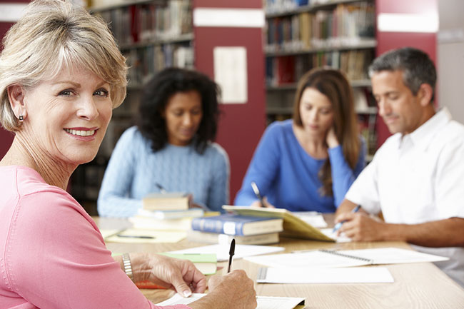 bigstock-Mature-students-working-in-lib-91343729.jpg