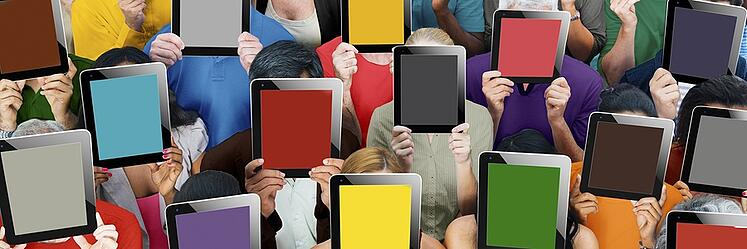 People Hiding their faces behind tablets