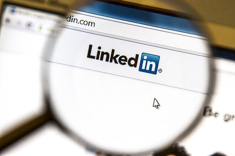 LinkedIn homepage under a magnifying glass